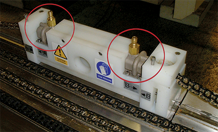 The new manifold (circled) built on 3D Systems' DMP system for the conveyor cleaning system for a bakery,