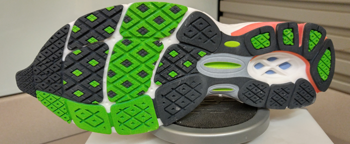 A 3D Systems ColorJet print of the New Balance 1260 V2 model sh oe, showing design details and the range of colors available to visualize data with realistic prototypes.