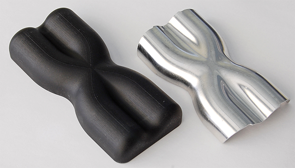 Final Hydroformed Part Next To 3D Printed Tool