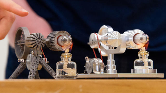 Redesigned, 3D-printed Sterling engine model on the left and original Sterling engine model on the right