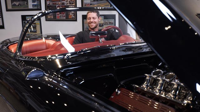 Metal fabricator Greg Hebard in a 1957 Corvette