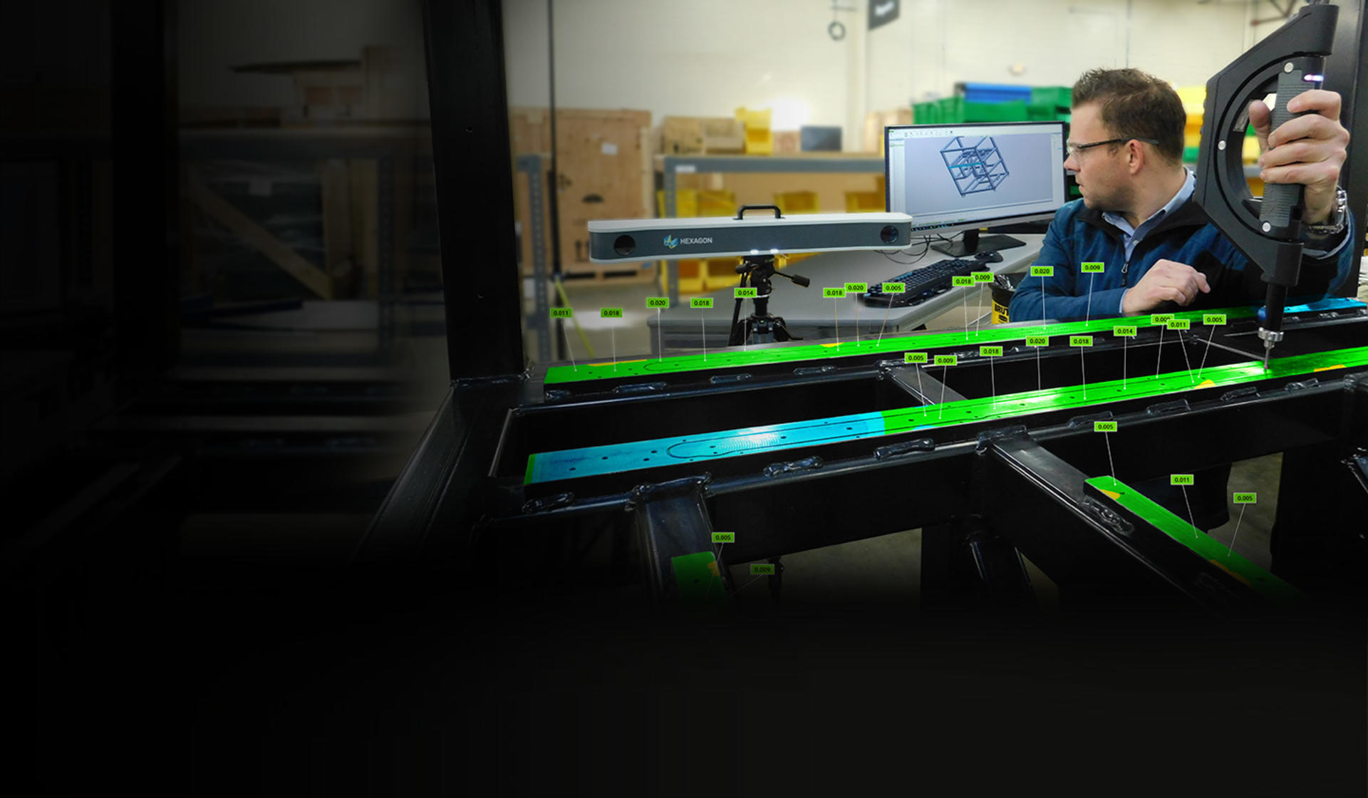 3D Systems program manager Bryan Rough inspects a ProX SLS 6100 3D printer frame using the AICON MoveInspect XR8 optical CMM and Geomagic Control X software.